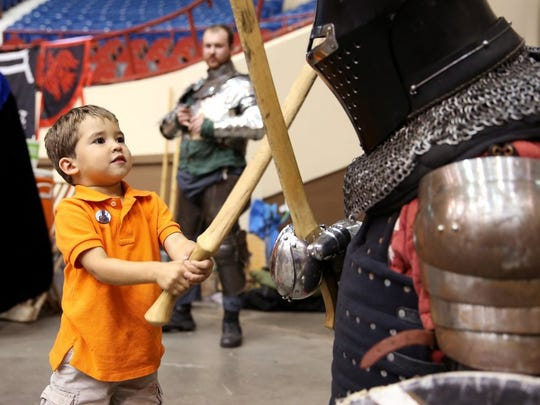 Stephen Nance, 3, fights a knight at San Angelo Comic Con on Saturday (Adam Sauceda/Standard-Times).