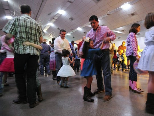 Thomas Metthe/Reporter-News   Rickey Stokes (right center) dances with his daughter, Brelynn, 6, during the 17th annual Daddy Daughter Date Night on Thursday, Feb. 11, 2016, at the Abilene Civic Center.