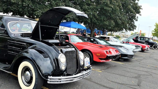 Custom cars are lined up for the fourth annual Family FunFest organized by Grant Me Hope. This year, the FunFest will take place at Holland Town Center and Nelis' Dutch Village on Saturday, Sept. 26.