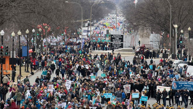 Anti-abortion demonstrators march toward the U.S. Supreme Court during the 44th annual March for Life in Washington, .
