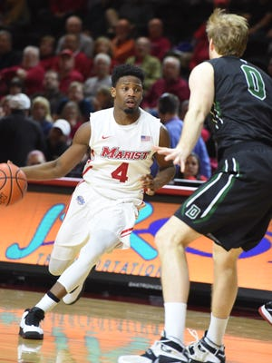 Marist College's Isaiah Lamb drives the ball during a Nov. 17 game against Dartmouth at McCann Arena.