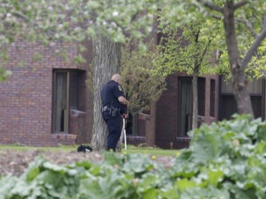 Police, some in body armor and carrying rifles, appeared to have surrounded North Central Health Care Thursday afternoon.