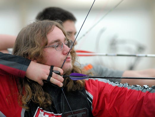Kendric Hubbard, 15, of Colorado, aims for a target in the 2014 National Field Archery Associations Indoor National Championship at Kentucky International Convention Center.  March 15, 2014