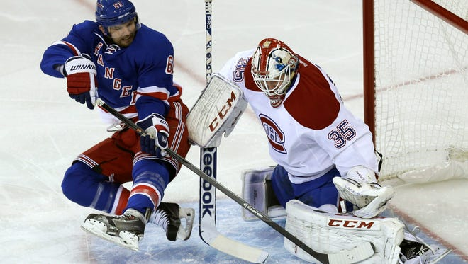 Canadiens goalie Dustin Tokarski blocks a shot by the Rangers' Rick Nash during the first period of Game 3 of the Eastern Conference finals Thursday night.