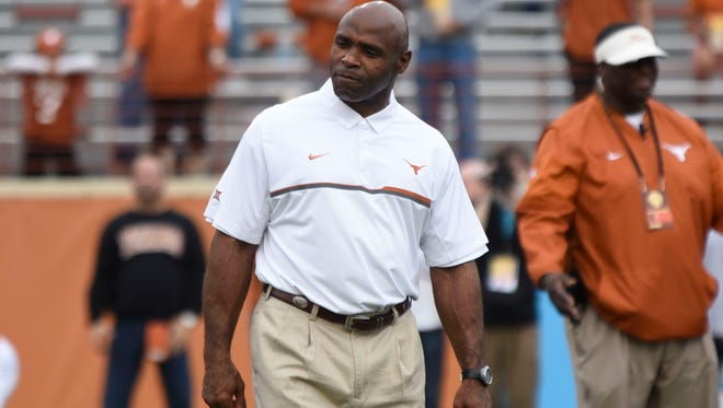 Texas coach Charlie Strong stands on the field prior to kickoff against TCU at Darrell K Royal-Texas Memorial Stadium.