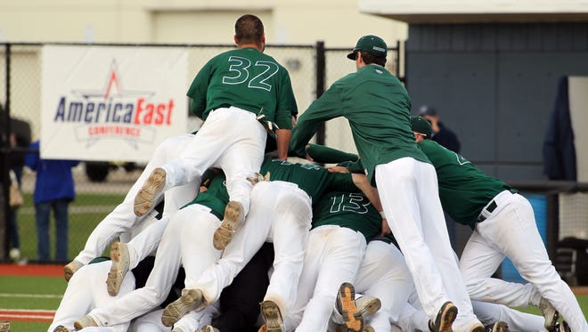 Binghamton University baseball players celebrate the first of back-to-back America East Conference championships at the University of Rhode Island's Bill Beck Field in Kingstown, R.I, Sunday, May 26, 2013.