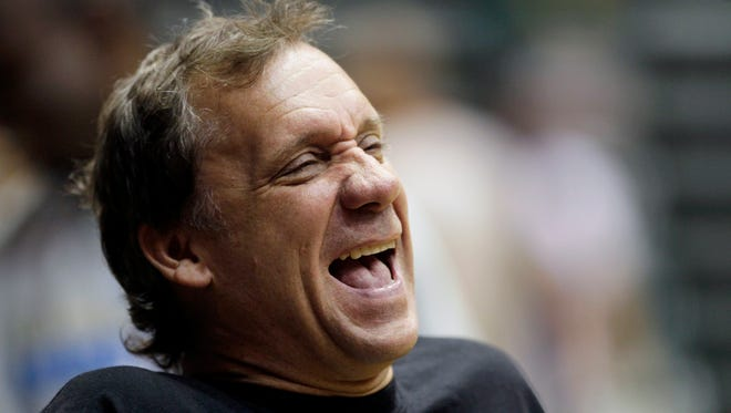 In this Sept. 29, 2010, file photo, Washington Wizards coach Flip Saunders laughs during NBA basketball training camp at the Patriot Center at George Mason University in Fairfax, Va. Saunders, the longtime NBA coach who won more than 650 games in nearly two decades and was trying to rebuild the Minnesota Timberwolves as team president, coach and part owner, died Sunday, Oct. 25, 2015, the team said. He was 60.