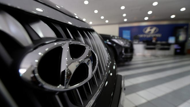 FILE - In this April 26, 2016 file photo, the logo of Hyundai Motor Co. is seen on a vehicle displayed at the company's showroom in Seoul, South Korea. Hyundai is recalling about 41,000 small SUVs in the U.S., Thursday, Sept. 15,  because a software glitch can stop the vehicles from accelerating. The recall came after pressure from the National Highway Traffic Safety Administration. It covers 2016 Tucson models with seven-speed dual-clutch automatic transmissions made from May 20, 2015 to May 31, 2016. (AP Photo/Ahn Young-joon)