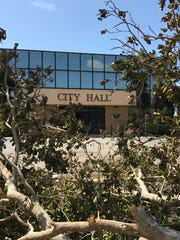 City Hall, which has exterior walls composed almost entirely of glass, was unscathed by Hurricane Irma, although there were several large uprooted trees in the parking lot.