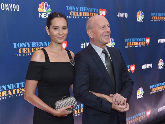 Emma Heming (L) and husband Bruce Willis attend Tony Bennett Celebrates 90: The Best Is Yet To Come at Radio City Music Hall.