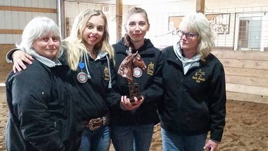 Coach Mary Gunter, left, Hailey Raymond, Xianna Higgins and Coach Brenda Bargender will participate in the WIHA State Tournament in Madison.