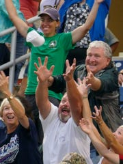 Pensacola Blue Wahoos fans compete for T-shirts being thrown into the crowd during a game in 2015 as the Blue Wahoos hosted the Biloxi Shuckers.