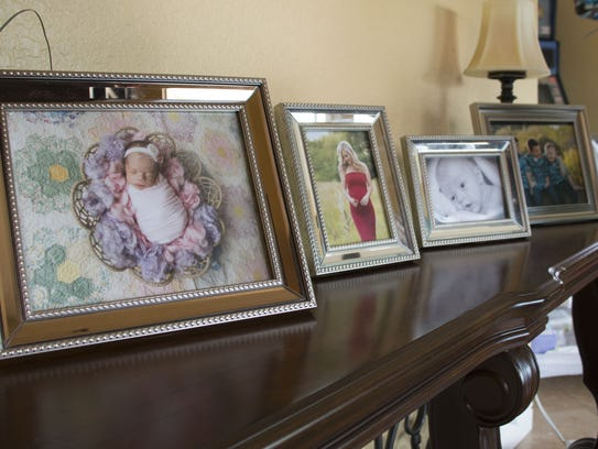 Family photos are displayed at Shannon Geise's home