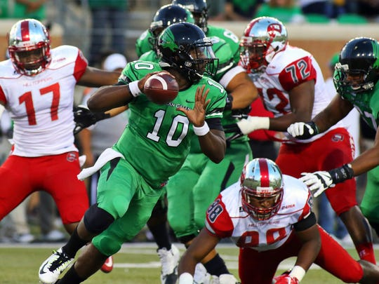 Oct 15, 2015; Denton, TX, USA; North Texas Mean Green quarterback DaMarcus Smith (10) scrambles against the Western Kentucky Hilltoppers during the first quarter of game at Apogee Stadium. Mandatory Credit: Ray Carlin-USA TODAY Sports