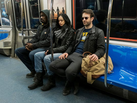 Mike Colter, left, Krysten Ritter and Charlie Cox star in Netflix's all-star Marvel series, 'The Defenders'.