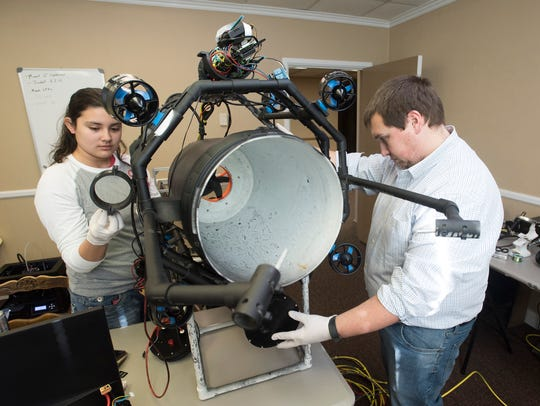 Kiara Korkuc and Brian Arnold work on completing a