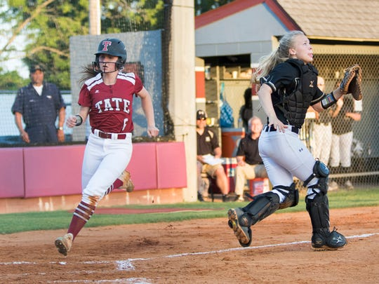 Ryleigh Cawby (6) crosses the plate for the first Aggie