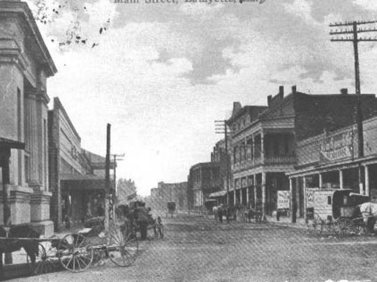 Main Street Lafayette in 1914. The 1859 Lafayette Parish Courthouse is on left.