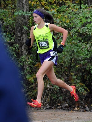 Mount Gilead's Baylee Hack runs in the regional cross country meet Saturday at Pickerington North High School, winning the race in 19:09 to qualify for Saturday's state meet.
