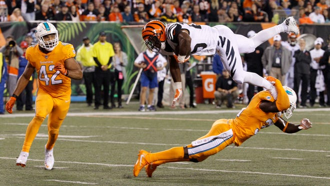Cincinnati Bengals running back Giovani Bernard (25) is upended on a carry in the third quarter of the NFL Week 4 game between the Cincinnati Bengals and the Miami Dolphins at Paul Brown Stadium on Thursday, Sept. 29, 2016. The Bengals improved to 2-2 with a 22-7 win over the Dolphins.