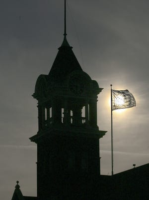 Dan Young/Marshfield News-HeraldThe low afternoon sun shines through a flag flying near Tower Hall in downtown Marshfield, Friday afternoon.