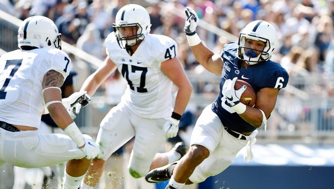 Penn State running back Andre Robinson, a Bishop McDevitt graduate, shouldered most of the running load with sophomore Mark Allen during Saturday's Blue-White Game.