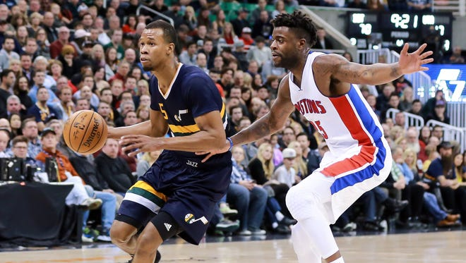 Jan 13, 2017; Salt Lake City, UT, USA; Jazz guard Rodney Hood gets past Pistons forward Reggie Bullock and goes to the basket in the fourth quarter at Vivint Smart Home Arena.