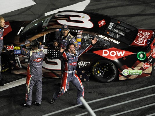Austin Dillon, center, celebrates with his crew after winning the NASCAR Cup series auto race at Charlotte Motor Speedway in Concord, N.C., Monday, May 29, 2017. (AP Photo/Mike McCarn)