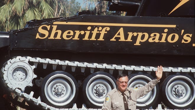 Sheriff Joe Arpaio waves to students at Larry Kennedy Middle School after debuting his newest symbol for his war on drugs, a M109-155 Howitzer Tank.