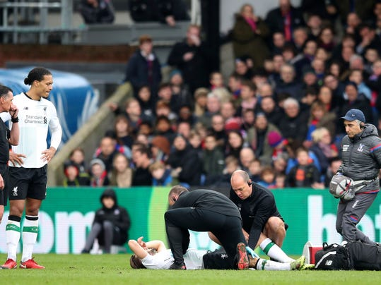 Liverpool's Adam Lallana lays injured on the pitch during the English Premier League soccer match between Crystal Palace and Liverpool, at Selhurst Park, in London, Saturday March 31, 2018. (Adam Davy/PA via AP)
