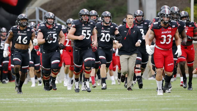 First-year coach Luke Fickell, shown here leading his Cincinnati Bearcats onto the field for the 2017 spring game, is about to do it for real. UC opens against Austin Peay on Thursday night.