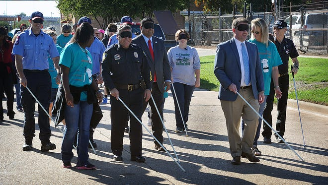 Beacon Lighthouse hosted White Cane Day Wednesday, giving members of the community a chance to experience a one-mile walk as a visually impaired person. The event helps educate the public about the many challenges faced by individuals with little or no eyesight.