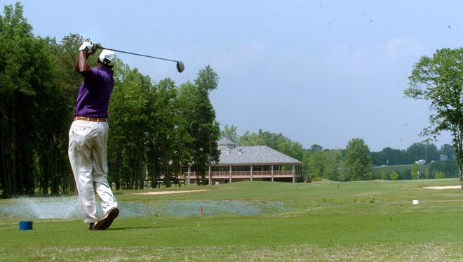 Clarence Darrington shown golfing at Gateway Golf Course in a Montgomery Advertiser file photo.