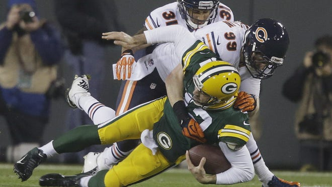Aaron Rodgers is knocked out of the game with a broken collarbone on a sack by Bears defensive end Shea McClellin on Nov. 4, 2013.