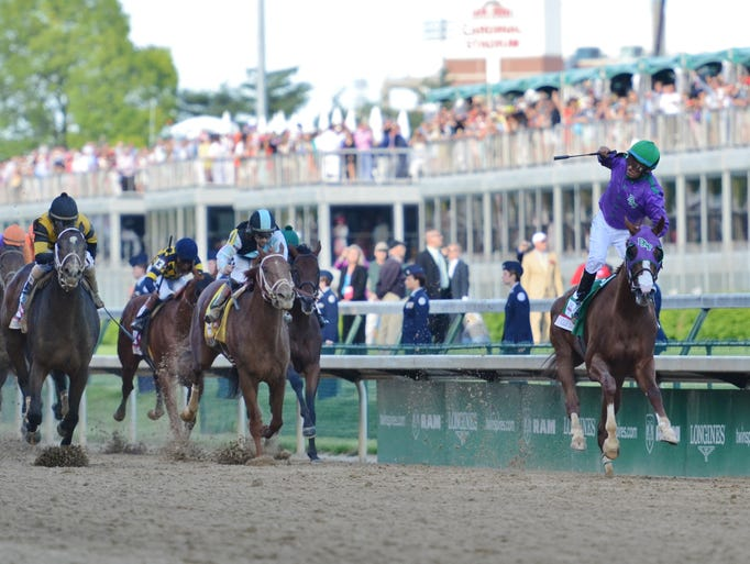 California Chrome wins the 140th Kentucky Derby. May 3, 2014.