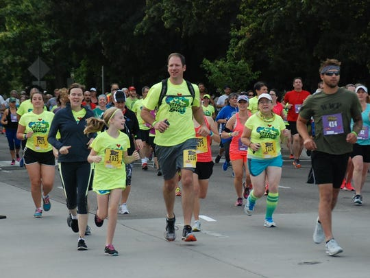 Hundreds of people take to the blocked off streets for the first annual High Street Hustle on Aug. 15, 2015 in Salem, Ore.