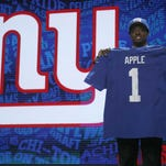 Eastern High School grad Eli Apple, poses for photos after being selected by New York Giants as the 10th pick in the first round of the 2016 NFL football draft on Thursday.