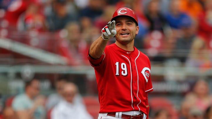 Reds first baseman Joey Votto smiles as Billy Hamilton