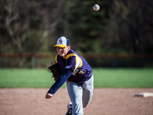 Eastern York's Brandon Knarr pitches during the game