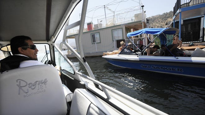 Roland Rojas, a senior Tulare County Lake Patrol attendant, checks on a boat at Lake Kaweah in this 2015 file photo.