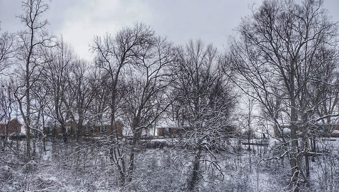 Snow blankets the landscape in Clarksville on Tuesday.