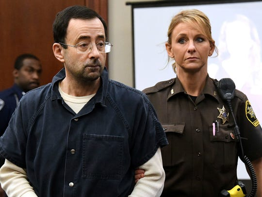 Larry Nassar is pictured being escorted into the courtroom