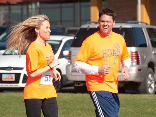"""Justin Osmond and his wife, Kristi run side-by-side at the """"Hear us Roar 5K"""" in Vernal."""
