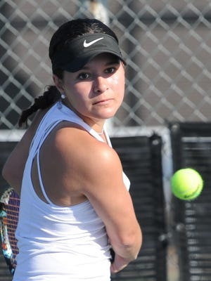 Wylie's Analeah Elias returns a shot in her girls singles semifinal match against Lubbock Monterey's Taylor Barnhill. Elias won the match 6-2, 6-3 in the Cougar Classic on Saturday, March 3, 2018 at the Abilene Tennis courts.