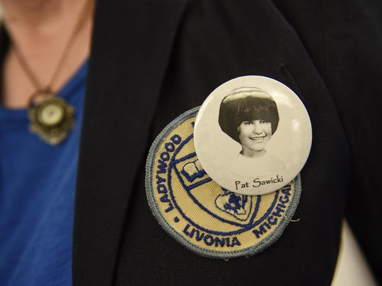 Pat Sawicki Seleski displays her button from the class of 1969.