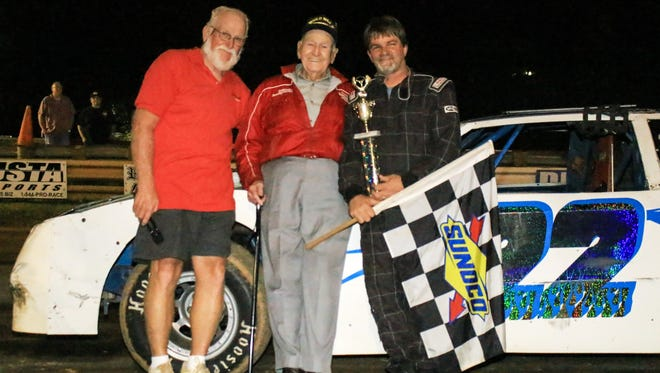 Al Gore, center, owner of Eastside Speedway, celebrated his 98th birthday Saturday at the track with his son, Gary, left, and Junior Humphreys, right, who won the Super Stocks race on the final night of the season at the dirt oval.