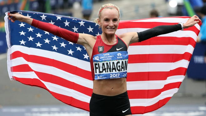 Shalane Flanagan celebrates after becoming the first American female to win the New York City Marathon in 40 years.