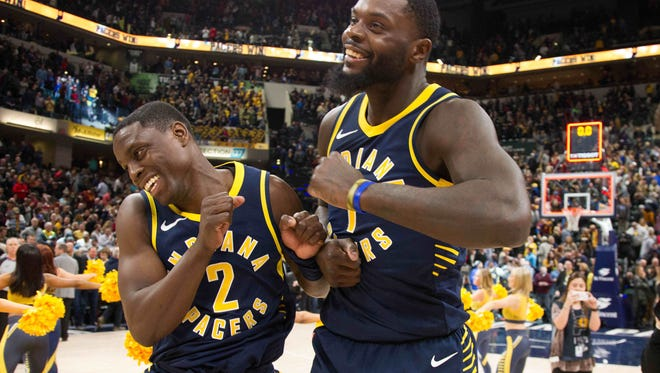 Jan 12, 2018; Indianapolis, IN, USA; Indiana Pacers guard Darren Collison (2) and guard Lance Stephenson (1) celebrate the win over the Cleveland Cavaliers at Bankers Life Fieldhouse. Mandatory Credit: Trevor Ruszkowski-USA TODAY Sports