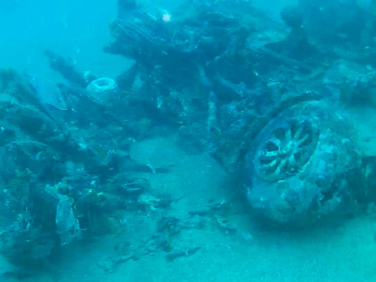 This October photo from a remote-controlled underwater camera provided by Project Recover shows the nose wheel of a B-24 bomber that crashed in Hansa Bay in what is now Papua New Guinea during World War II.