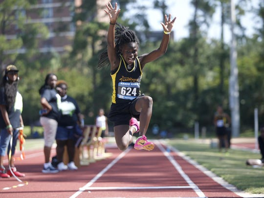 Angel Roberts competes in the long jump during Ernie Sims track invitational Saturday at FSU's Mike Long Track, a part of the local football star's 8th annual charity weekend.